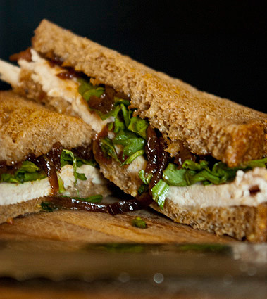 Turkey sandwich with caramelized onion jam, mayo, and arugula
