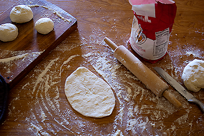 Rolling out homemade pita